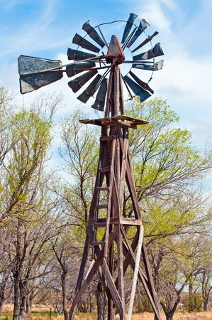 Old broken down windmill, formerly used to water livestock. Stock Photo - 4834273