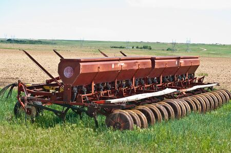 seed drill: A seed drill sets while waiting for the newly planted seed to sprout. Stock Photo