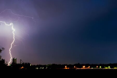 tremendous: Tremendous bolt of lightning strikes the ground in a rural town Stock Photo