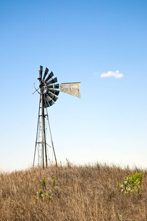 Broken windmill perched on top of a small hill. Stock Photo - 5318592