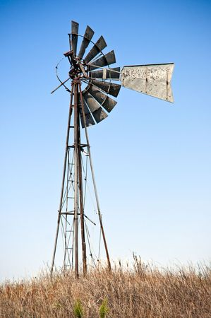 Old windmill, worn out from years of hard work. Stock Photo - 5318593