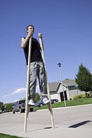 Using stilts to take those long steps in a suburban neighborhood. photo