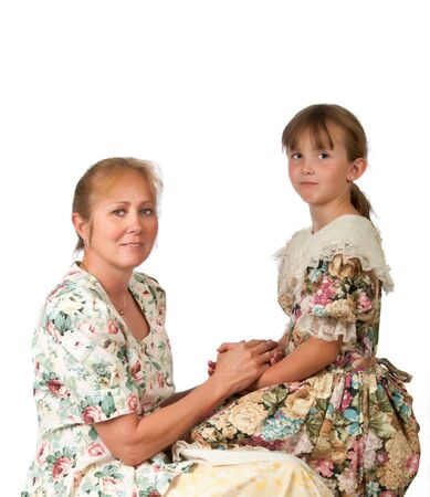 thier: Pretty woman and her granddaughter in thier sunday dresses.