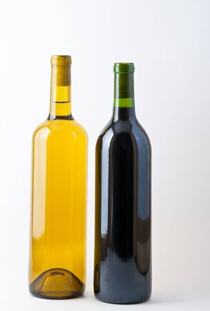 unopened: Two unopened bottles of wine, side by side