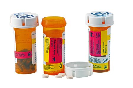 pill bottle: Three bottles of medicine with child proof caps