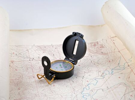 topographical: Topographical map with a compass sitting on it.