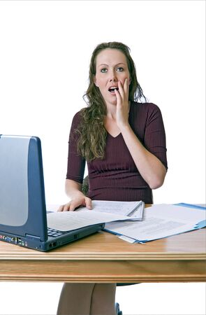 Young woman at a computer desk has a sudden realization. Stock Photo