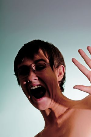assailant: Teenage boy showing terror and fear from an unknown assailant. Stock Photo