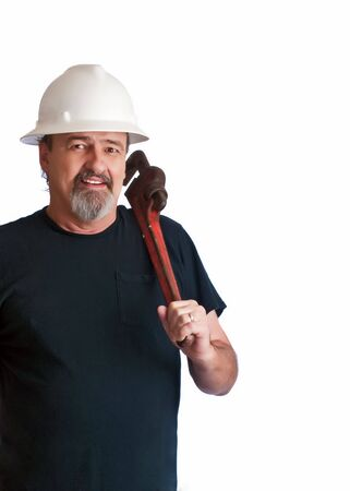 Working man ready to work on some broken pipes. photo