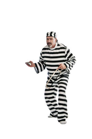 convict: Escaped convict sneaking around with a .25 automatic pistol Stock Photo
