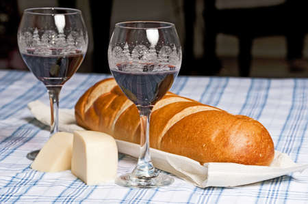 French bread, cheese and wine in Christmas glasses to celebrate the season.