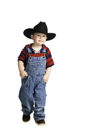 Cute baby wearing his cowboy clothes while playing photo