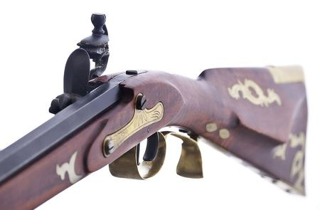 flint: Replica flint lock rifle, close up fiew shoing the inlayed brass and engravings. Stock Photo