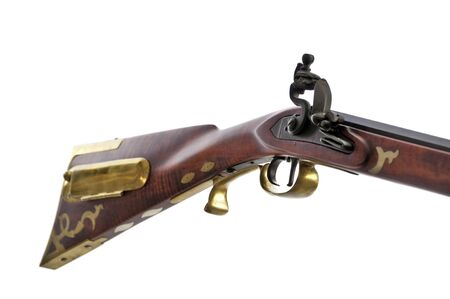black powder: close up view of black powder rifle showing the brass inlays and patch box on the stock.