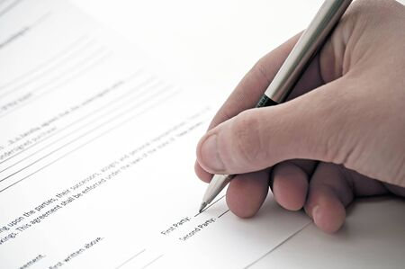 autograph: Agreeing to the terms of a contract by signing it.