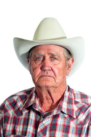 Cowboy with the years of experience written in the lines of his face. Stock Photo