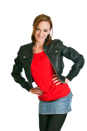 Pretty young model with style wearing a leather jacket isolated on a white background. photo
