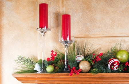 Fireplace mantle decorated with candles and garlands for Christmas photo