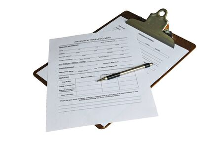 Application for employment and a pen ready to be filled out. Isolated with a clipping path photo