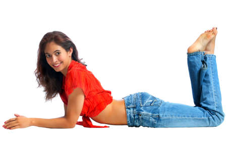 Brunette woman relaxing on the floor. Isolated on a pure white background Stock Photo - 9449186
