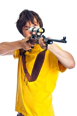 Young adult male pointing a 30-06 hunting rifle, aiming with a scope. Isolated on white