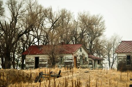 Ramshackle farm buildings empty and abandoned on the Colorado, USA high plains.