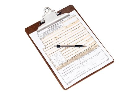 Application for a U.S. passport on a clipboard with a pen. Isolated on white