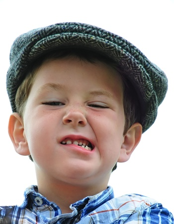 Cute little boy playing like a tough guy in a driving hat. Stock Photo - 10486750