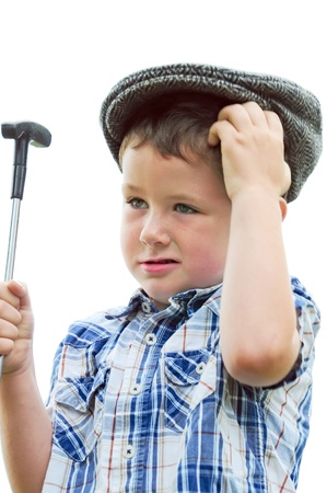 messed up: Cute little boy wondering how he messed up that last putt. Stock Photo