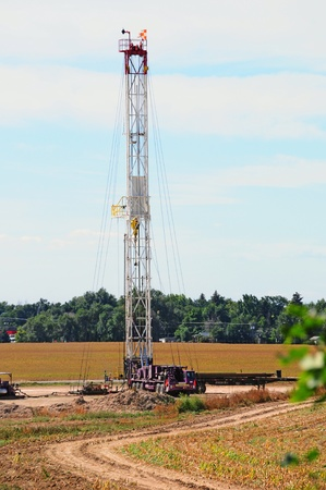 Service rig setting up a newly drilled gas well for production