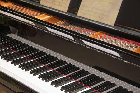 Close-up view of a grand piano keyboard Stock Photo