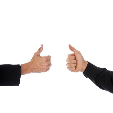 Hands of a man and a woman giving a thumbs up to show agreement. photo