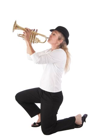 Pretty blonde woman playing blues on a trumpet. Isolated on white background