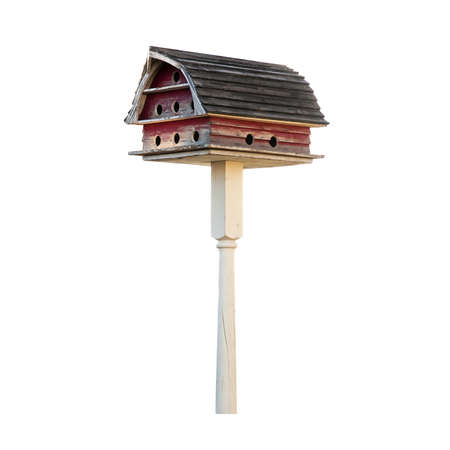 roost: Purple Martin birdhouse made to look like a barn with a Gambrel roof. Isolated on white with a clipping path.