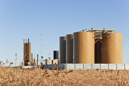 oilfield: Storage tanks and treater for separating water from crude or condensate from natural gas in central Colorado, USA. Stock Photo