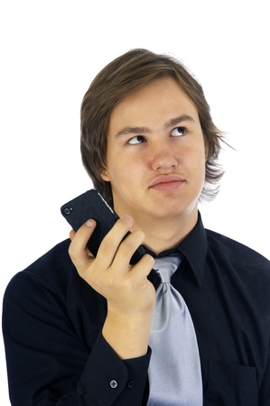 Young man rolling his eyes as a result of a text on his cellphone. Stock Photo - 11538378
