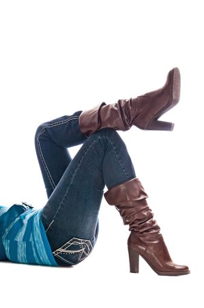 shapely: Shapely woman legs with fashion boots over denim jeans Stock Photo