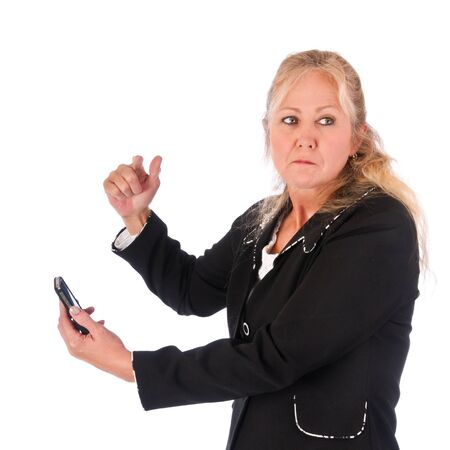 Adult woman angry about a message on her cellphone looking back over her shoulder. Isolated on a white background. photo