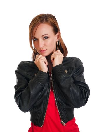 Serious looking young woman looking beautiful in a black leather jacket and short red dress photo