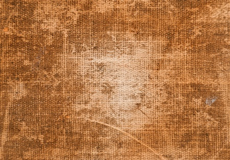 Rough burlap fabric weathered with time for backgrounds photo