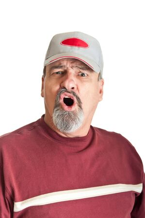 Mature man wearing a hat with a dissapointed look on his face after checking his lottery ticket  photo