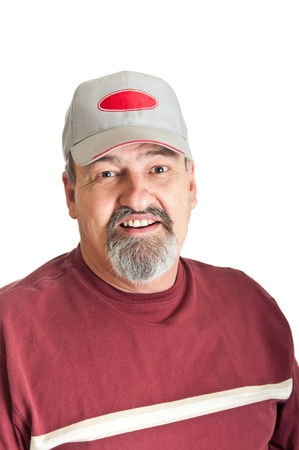 Good natured smile from a sixty five year old man wearing a baseball cap  isolated on a white background  photo