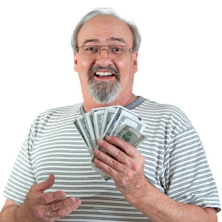 payday: Mature man smiles while holding a handful of American hundred dollar bills. Isolated on a white background.