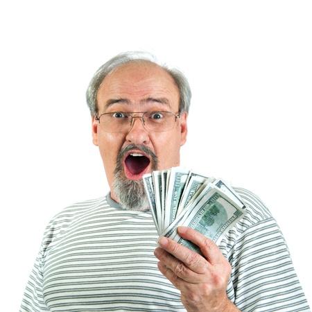 Erwachsene männliche zeigt ein Blick des Staunens und der Überraschung, während eine Handvoll von hundert Dollar-Scheine von amerikanischem Geld. Standard-Bild - 13115926