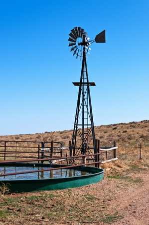 Windmill and tank on the Pawnee National Grasslands to provide drinking water for livestock.  Editoriali