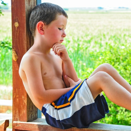 freckles: Small Boy Taking a Break on a Hot Summer Day Stock Photo