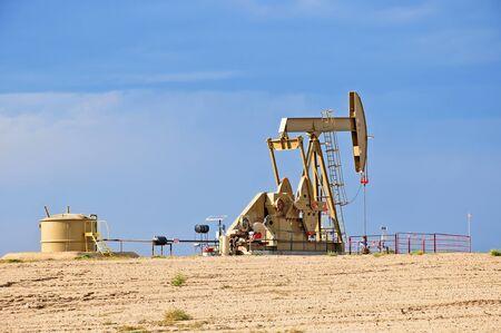 depletion: Crude Oil Pump Jack Against a Blue Sky