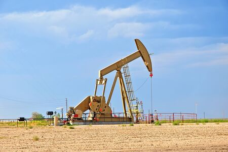 Large Pump Jack Pulling Crude Oil Up Stock Photo - 14838171