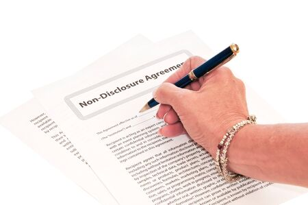 confidentiality: Woman Signing NDA Form