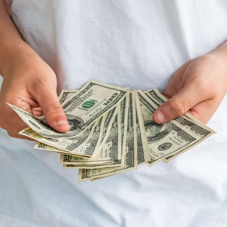 dollar bills: One hundred dollar bills held in a loose fan. Stock Photo